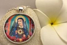 My wonderful pendants / This gorgeous necklace with pendant mounted by a cabochon portrays Frida Kahlo painted by an artist as the Sacred Heart of Jesus.