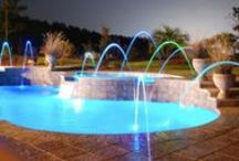 Swimming Pool Water Features / The lively sight and sound that a water feature brings, enriches and adds elegance to virtually any outdoor environment!