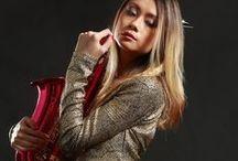 Sapphire Ng   Gold Dress/Saxo /   https://www.facebook.com/SapphireNgGuitarist       http://www.sapphire-love.blogspot.sg/    http://www.modelmayhem.com/SapphireNg      https://plus.google.com/+SapphireNgGuitarist/posts       http://www.youtube.com/user/SapphireNgGuitarist/videos