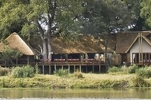 Simbavati River Lodge / Our accommodation consists of eight luxury tents and three chalets; all are privately situated, comfortably furnished and with en-suite facilities.