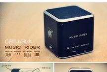 Music Rider / Music Rider est un mini haut parleur leger et compact en format de poche avec une qualité de son extraordinaire et incomparable. Son design unique vous permettra de profiter de votre musique où vous le souhaitez et de bénéficier ainsi d'une expérience musicale parfaite. Il peut se connecter à un MP3, MP4, CD, DVD, IPOD, IPHONE, IPAD, GPS, PSP, smartphone, ordinateur portable ou insérer une carte Micro SD/T (non fournie).