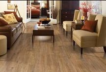 """Laminate Flooring / Experience the latest in laminate flooring! Where else but Olson Rug? Come see imported exotics, hand scraped styling, 4"""" & 5"""" restoration planks, """"Piano"""" finishes.... all that is new and exciting in the world of laminate flooring."""