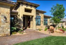 Northbridge - St. George / A craftsman style, luxury home situated in the heart of the Red Rocks in Southern Utah, this masterpiece marries two significantly varying styles. Lane Myers Construction has custom built this home to have the outer appearance of surrounding homes- a desert contemporary style at first glance- yet upon entry, has the comfort and detail of a craftsman home.
