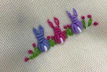 Bullion stitch. / A knot stitch: Bullion stitch.