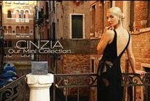 """CINZIA - Our Mini Collection / The Cinzia, our mini size handbag comes in a multiple of eye-catching and traditional colors in such exquisite materials as lizard, python and lambskin.  This bag may be worn as cross body, double chain shoulder bag or clutch.   Dimensions:  Closed: 7.5"""" x 6.5"""" Open: 7.5"""" x 16.75""""  Handmade in Italy."""