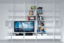 SYSTEM bookcases / system is characterised by extending aluminium profiles, which adapt to various room heights.