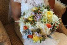 Saint Anthony Main wedding / Bridal bouquet and other personal flowers in an urban setting off the river in Minneapolis. Floral designed by Artemisia Studios, a Twin Cities wedding florist.