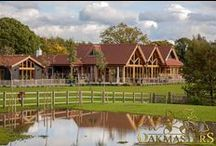 Oakmasters / Oakmasters specialises in the design, supply and installation of beautifully finished, tailor made, structural oakwork.  Oak framed homes, poolbuildings, porches, garages and outbuildings, oak beams, roofs and trusses, sunrooms, oak furniture.