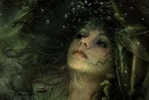 Mermaids / Deep down in the big blue they live, floating softly through their element. We humans only get a rare glimpse at them, when their curiousity conquers their good sense...