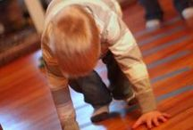 Big Muscle Activities (Gross Motor) / Play that uses a child's large muscle groups will help with crawling, walking and running over time.