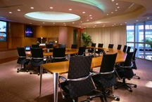 Interim Services, Ft. Lauderdale, Florida / The 790-square-foot corporate boardroom at Interim Service's headquarters, in Ft. Lauderdale, Fl (USA), represents a state of the art combination of traditional boardroom configurations with audio/video/conferencing and presentation ergonomics. Room layout focused on the two primary uses of the room; conventional board meetings, and advanced media conferencing, placed so that there's no disruption to the room's permanent table layout and architecture.