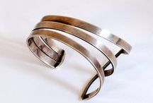 Cuff bracelets / Gorgeous cuff bracelets in silver, gold, brass, leather or even wood.  Stylish and bold cuffs will add some glam to any look.