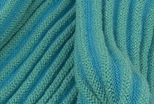 Continuous loop undulating texture scarves / These scarves are knit in two different yarns which have to be carefully chosen to knit up in this undulating stitch texture. The continuous loop scarf has no ends - you can wear it around your shoulders, or wrap it twice for a soft snuggly neck scarf.