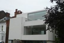 Willoughby Road / The project involved the construction of a new four-storey house in Hampstead. The structure consists of timber floors supported on a steel frame with an infill masonry perimeter skin. The external walls are clad in insulation and render. At the front, a tensioned phosphor bronze double screen provided shading and security whilst also acting as a trellise for planting.