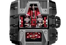 T-1000  / The T-1000 featuring the world's longest power reserve; vertical roller-borne hour and minute indications; and muscular case in natural and blackened titanium. For more information, please visit: http://www.rebellion-timepieces.com/collection-t-1000-gotham.php#1