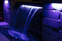 Colorfalls - Lighted Spillway / Atlantic's original Colorfalls brought the Formal Spillway to the Backyard Oasis, and they're still the perfect fit for all your vertical wall applications. Whether your wall is brick or block, natural stone or ceramic tile, you can add the beauty of shimmering brilliance in red, white or blue to your water feature, day and night! Also available in color changing!