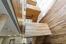 Cantileverd Straight Staircase Oxford University / Cantilevered stair over 3 floors 78 risers. Fully timber clad with stainless steel handrail.