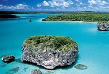 """New Caledonia : The Isles of pines / At twenty-minute flight south of Noumea, this island concentrates all the beauties of the Pacific. Beginning with a relaxed way of life, the smile on the local's faces and their talent to never rush the time. « A quoi bon le compter, il ne s'arrêtera jamais » - (""""Why measure the time, it will never end""""), they seem to try to help us understand."""