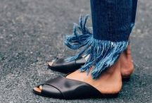 Frayed Denim / Frayed, torn jeans have never been more trendy. All fashionistas worldwide are proudly wearing cropped jackets, frayed kick flare jeans and ruffled denim skirts that they style with retro band t-shirts, circle bags and pointed flats or python ankle boots. Fringed jeans are very popular in the street style too, especially with logo belts and block glove heels.
