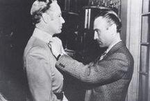 """Walter Plunkett / El diseñador estadounidense Walter Plunkett ideó el vestuario de más de 160 películas. Entre sus creaciones más famosas : """"Lo que el viento se llevó"""" (1939) y """"Cantando bajo la lluvia"""" (1952). Nominado nueve veces a los premios Óscar, se alzó con el galardón en 1951 por """"Un americano en París""""."""