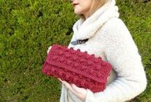 BUGS & CLUTCHES / All of our unique bags are carefully handmade. Knitted purses (the last trend in woman's fashion) are available in many designs and shades . Our leather bags are so easy to wear every day. So lovable and personalized , since you can ask us to use any charm from  our collection to decorate your bag