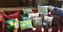 Cushions on display at Broughton Castle / Broughton Castle Exhibition  From 1st may  to  3rd July  at Broughton Castle Banbury, Oxfordshire OX15 5EB by Banbury & District Embroiderers Guild Branch as part of the Capability Brown Celebrations.