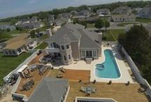 Amazing Decks and Pools / Take time for fun and recreation in your own backyard. Whether it's swim time, or taking in rays, we have a large list of homes that suite your lifestyle!  www.jacklingo.com 800-345-3469