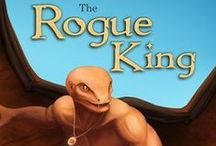 The Rogue King / This is a story which follows the young outcast, Koral, as he becomes the most feared man in a land where magic is rife and the locals are truly at the whim of gods. It is here where the Rogues are considered the worst of the damned. Join me and discover how this magicless man remains their king.
