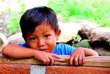 1.. 2... 3... smile! / In ogni angolo del pianeta i bambini dovrebbero sorridere, ma a volte fanno fatica...