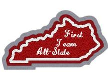 State Shape Patches / Put yourself on the map with our custom-made chenille state patches! Consider our collection of state patches blank canvases for you to display anything from state championships to tournament appearances! Our state patches will beautifully display your students' hard work and achievements. Just choose your home state, add your text, and select from a variety of with musical, academic or mascot inserts!