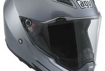 """AGV AX-8 EVO Naked / The AGV AX-8 Naked Helmet is the street version of the AX-8  EVO. It features internal padding with increased thickness for improved comfort and greater stability. The shape for the outer shell in the chin area combined with a wider and softer base edge reduces interference with any back protector used and decreases risks of impact traumas, thanks to its """"shock-absorber"""" function."""