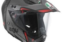AGV AX-8 Dual EVO / The AX-8 Dual Evo is an extremely versatile helmet that is ideally suited for both on and off-road use. Its design resembles the AX-8 Evo motocross version on which it was modelled. Thanks however to additional technical features such as the visor and its special opening mechanism, the open/shut chin air vent and extra ventilation on the top, this helmet provides the same superb performance and comfort as a road helmet. / by AGV Helmets Official