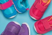 First Walker / As toddlers discover walking, their Soft Motion™ shoes ensure toes have room to wiggle, flex and grow naturally. The rounded outsoles improve balance, helping kiddos navigate new obstacles. Baby's first walking shoe.