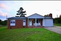 Beautiful Ranch Home in Gastonia! / Beautifully remodeled, move-in ready, ranch style home located in an established neighborhood! This updated home is ready to move in and has been completely renovated! Hardwoods floors in great condition. Spacious eat in kitchen with sliding door to the deck. Wood burning fireplace in the den w/ detailed ceiling design. Large backyard, perfect for entertaining guests. New HVAC, new carpet, new paint, new bathroom, new kitchen cabinets and more! This home is a must see. Home Warranty available!