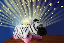 Dream Lites / From the creators of Pillow Pets® come Dream Lites a childs night light that will transform your ceiling in a starry sky. Dream Lights have soothing lights to help little ones drift off to sleep. Buy online in UK from www.dreamlitespillowpets.co.uk