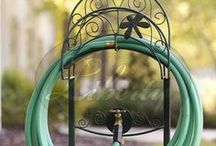 Liberty Garden Hose Stands / These attractive and decorative hose stands look great on any lawn while holding your hoses neatly until you need them. Features easy to place anchors that secure your stand into the turf.