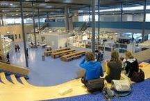 VIA Kampen / The workshops on the ground floor are surrounded by a large balcony (for instruction). One large roof covers all. Vocational Training. 700 students. In Kampen, the Netherlands.