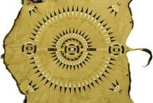 Buffalo, Elk and Deer Robes / Many of the robes and hides featured utilize the traditional Native American beadwork and stitching. Each piece of American Indian art also depicts symbols and images significant to the Plains Indians.