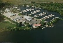 Our Inventory & Marina~ Pick Your Pleasure! / Starved Rock Marina was established in 1957 and is a full service marina offering sales of Rinker Boats and Landau Pontoons. We also have a large selection of quality Pre-Owned and brokerage boats. We are located on the scenic Illinois River across from beautiful Starved Rock State Park, approximately one hour from the Chicago suburbs, Rockford, Peoria, and the Quad City area. The Illinois River has access to both Lake Michigan and the Mississippi River.