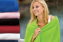 Towels and Blankets for Your Company / These embroidered towels and blankets are perfect for your company's golf tournament or a meeting with that other office by the beach. EZ Corporate Clothing will make sure you are representing your company no matter where you go. All of these promotional items can be personalized with your company's logo or event design.