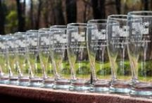Lighthouse Lazer / What a fantastic way to make your wedding day even more special, with personalized, engraved glassware to use for your signature drink and then guests get to take them home! Lighthouse Lazer also designs and creates bridal party gifts, unique guest books, monograms, cake toppers, table numbers and the list goes on!  Visit our Facebook page or website: http://www.lighthouselazer.com/