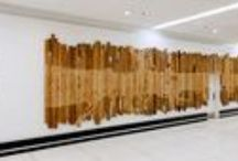 """New Terminal Art Debuts in Terminal 3 / New Artwork has debuted in Terminal 3's Arrivals level. Pontus Willfors' """"Douglas Fir Reclaimed"""" features salvaged planks of Douglas fir. In the same hallway, Cathy Weiss' installation, """"Laurel Canyon, Chaparral Habitat: Native Flora and Fauna"""" features large-scale, boldly colored woodcut prints inspired by the indigenous wonders of Laurel Canyon in the Hollywood Hills. On display until June 2016."""