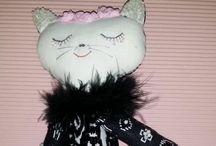 Annie R. Teo Cloth dolls and Ménagerie / I like to use colorful Malaysian & Sarawak (Borneo) batik to create beaded cat dolls and cloth dolls