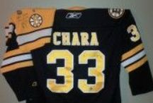 Boston Bruins / Boston Bruin jerseys displayed using the Ultra Mount jersey display hanger. A great affordable alternative to jersey frames.