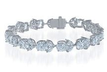 Beautiful Bracelets / An art deco wedding look isn't complete without a stack of glittering sterling silver and simulated diamond tennis bracelets by DANI by Daniel K.