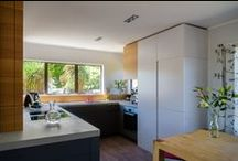 IMI Beton kitchen / Kitchen with Imi Beton bench top, ultra mat paint finish fronts & a pink tap