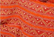 """Kantha (India, Bangladesh) / Nakshi kantha, a type of embroidered quilt, is a centuries-old Bengali art tradition. The kantha was entirely made out of re-used cloth and they were not intended to be sold. The most common Nakshi Kantha products are quilts. Whether a summer or winter wrap is required, old discarded saris and cloth are layered accordingly. The women then use various forms of a running stitch ( """"kantha stitch"""") to embroider the quilt. It is said that the Nakshi Kantha items are blessed with protective powers."""
