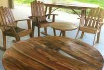 Rustic Wooden Furniture / A variety of materials such as gnarly blackwood, black wattle, recycled oak staves, steel frameworks and clear resin to lend the table tops a refined rustic quality.