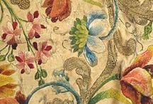 Tecidos bordados e rendas