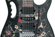 Guitars / by Carla Zampar